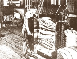 Volunteers bale and package used clothing to send to Europe after World War II. Photo courtesy of Brethren Historical Library and Archives.