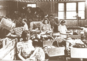 Women sort relief clothing to be sent to Europe. Photo courtesy of Brethren Historical Library and Archives.
