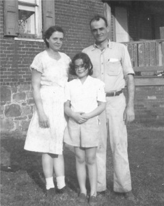 Olive and Roger Roop in a later photo with one of their daughters. Photo courtesy of Rouford Coonts.