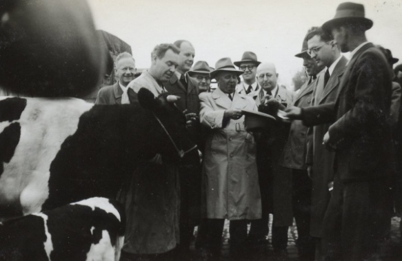 A farmer draws his number from a hat during a 1952 distribution ceremony. Photo courtesy of David Brightbill.