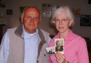 Peggy with Cornelius Queling and photos he brought to the meeting, one of him as a young man and one of then heifer his family received. Photo by Mr. Arts.