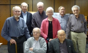 Seagoing cowboys at the Kalona (IA) Mennonite Church, May 3, 2016. Left to right, seated: Emil Ropp, Henry Mullett; standing: Levi Miller, Charles Silliman, Weldon Beach, Peggy Reiff Miller, Paul Walther, Wallace Fisher. Photo credit: Mary Lou Farmer.
