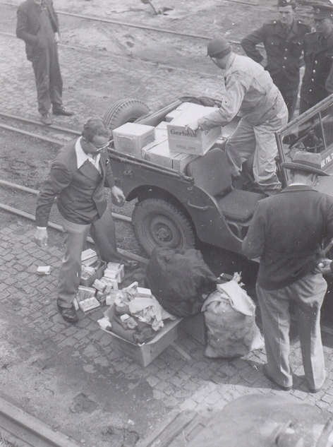 Cowboys load an Army jeep in Bremen with the relief supplies they brought along and fruit they had saved from their meals on the ship. Peggy Reiff Miller collection, courtesy of Ivan Meck and Guy Buch.