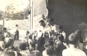 Besides the official cargo on the Virginian, the cowboys had brought along items like soap, needles, thread, buttons, etc., which Orville is distributing here to Greeks in Salonika. Photo courtesy of Heifer International.