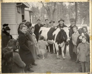 Hope the Heifer at the Villa Skaut orphanage in Konstancin, Poland, Christmas Eve, 1946. Attended left to right by Harvey Stump, Lee Cory, John Miller, and L. W. Shultz.